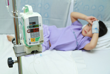 Asian children patient sleeping in hospital bed photo