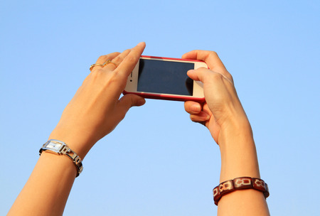 Hand hold smartphone to take photo photo