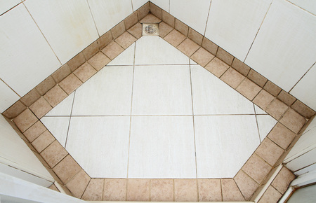 diamond shaped: Dirty tiled floor in diamond shaped pattern