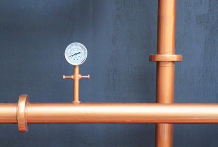 Pressure gauge meter installed on copper pipes photo