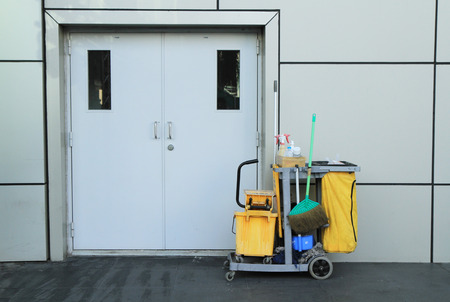 Cleaning tools in front of building door