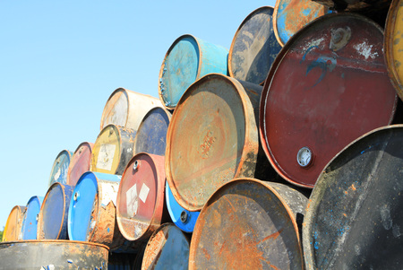 grabber: Pile of rusty fuel and chemical drums