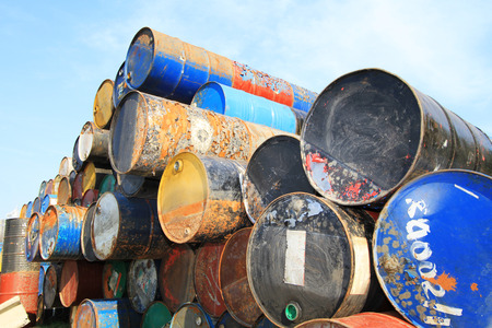 Pile of rusty fuel and chemical drums photo