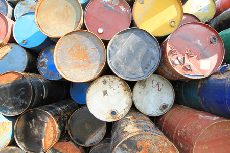 chemical hazard: Pile of rusty fuel and chemical drums