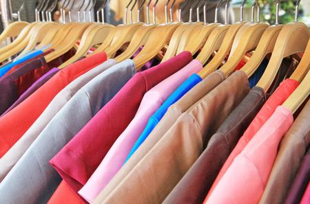 Thai silk clothes on hangers photo