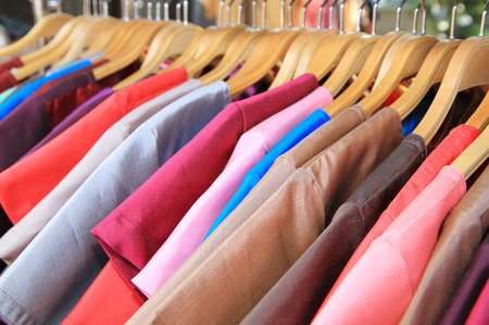 sleeved: Thai silk clothes on hangers Stock Photo