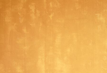 Gele betonnen muur geweven achtergrond. Stockfoto