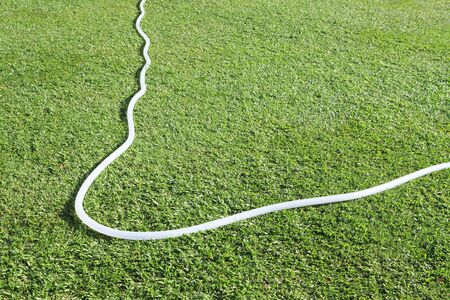 plastic conduit: Rubber tube on green field