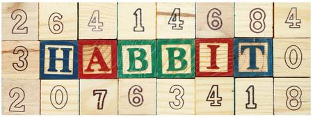 habbit: Word HABBIT from alphabet wooden blocks Stock Photo