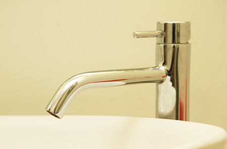 handbasin: Stainless faucet Stock Photo