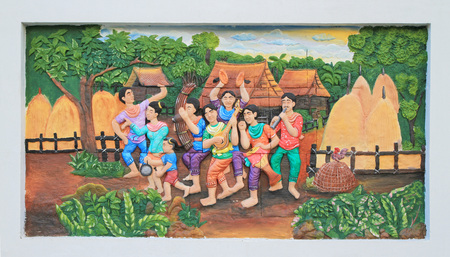 thai musical instrument: Stone carving of traditional Thai musical instrument on temple wall