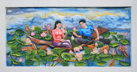 thai culture: Stone carving and painting of Traditional Thai culture on temple wall Stock Photo