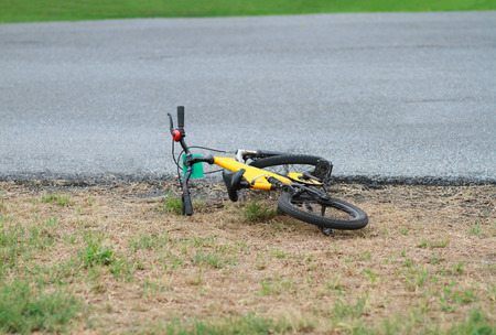 cycler: Yellow bike fell off beside the street