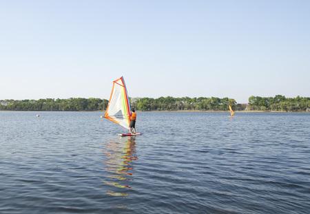 windsurf: Man winsurfing on calm lake