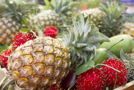 Pineapples and other tropical fruit at asian market
