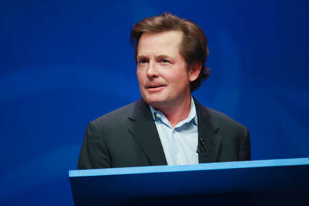 j: ORLANDO, FLORIDA – JANUARY 16, 2012: Actor Michael J. Fox delivers an address to IBM Lotusphere 2012 conference on January 16, 2012. He tells how social networks help him fight his Parkinson Editorial
