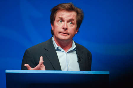 ORLANDO, FLORIDA – JANUARY 16, 2012: Actor Michael J. Fox delivers an address to IBM Lotusphere 2012 conference on January 16, 2012. He tells how social networks help him fight his Parkinson Editorial