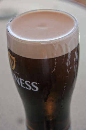DUBLIN, IRELAND - JUNE 19, 2008: Pint of beer served at The Guinness Brewery on June 19, 2008. Brewery where 2.5 million pints of stout are brewed daily was founded by Arthur Guinness in 1759