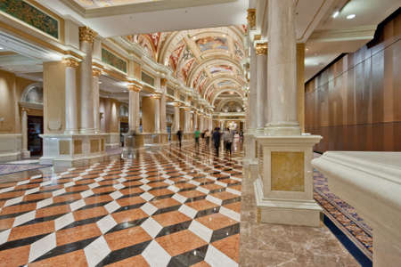 Luxury classic colonnade corridor with marble floor and curved arch ceiling at Venetian hotel in Las Vegas, Nevada