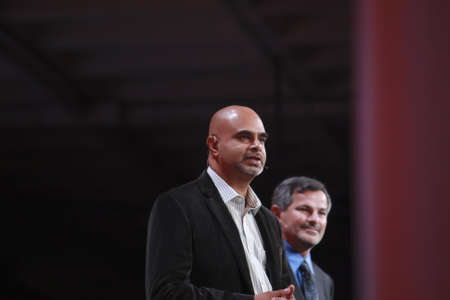 SAN FRANCISCO, CA, OCT 1, 2012 - PayPal  Vice President Technology Operations Nat Natarajan (left) makes speech at Oracle OpenWorld conference in Moscone center on Oct 1, 2012 in San Francisco, CA Stock Photo - 15927353