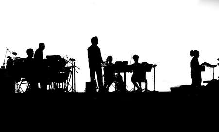 Musicians of rock band playing on tablets in black and white silhouette
