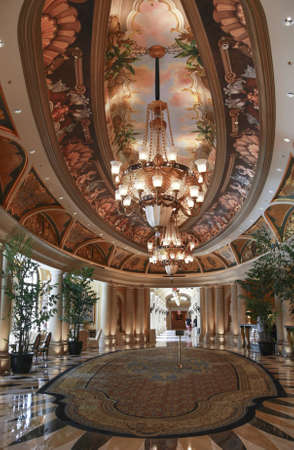 luster: Luxury classic colonnade corridor issued from hall with ornate luster
