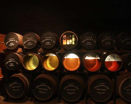 Cork, Ireland - June 20, 2008:  Transparent bottom barrels with specimens in Old Midleton Distillery museum of Irish whiskey in Cork on June 20, 2008   Editorial