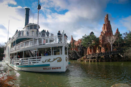 PARIS, FRANCE - NOVEMBER 18, 2009  Pleasure ship Molly Brown at artificial river in Disneyland Paris on November 18, 2009  It is the most visited attraction in all of France and Europe Stock Photo - 23543594