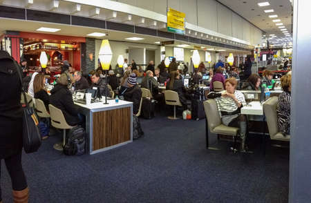 NEW YORK CITY, USA, MARCH 3, 2014 - Internet cafe equipped with iPads at JFK airport terminal on March 5, 2014 in New York City, USA  JFK is the busiest hub for international flights in North America