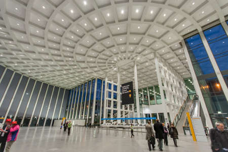 messe: BERLIN, GERMANY � NOVEMBER 11, 2014: Attendees inside Messe Berlin Entrance South at SAP TechEd 2014 conference on November 11, 2014 in Berlin, Germany Editorial