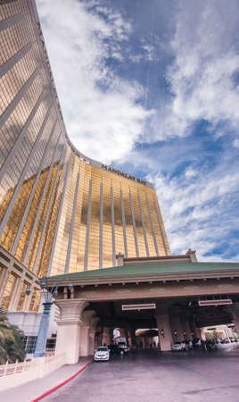 LAS VEGAS, NEVADA - JUNE 11, 2013: Mandalay Bay resort and casino hotel main entrance in Las Vegas on June 11, 2013. Mandalay Bay with gold colored exterior was opened in 1999.