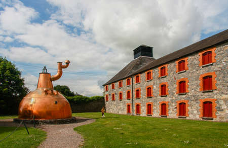co cork: CORK IRELAND  JUNE 20 2008:  Old big copper whiskey distillery on stone foundation at the Jameson Heritage Centre  in Midleton Co. Cork 12 miles east of Cork City on the main Cork Waterford Road. Editorial