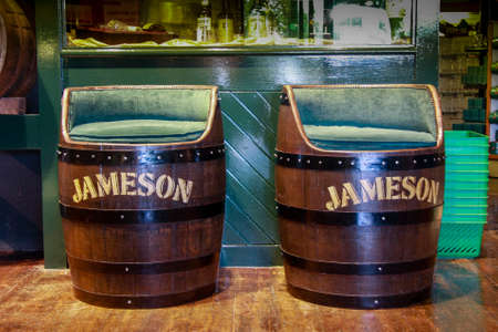 co cork: CORK IRELAND  JUNE 20 2008: Decorative Jameson Irish whiskey barrel armchairs at the Jameson Heritage Centre  in Midleton Co. Cork 12 miles east of Cork City on the main Cork Waterford Road.