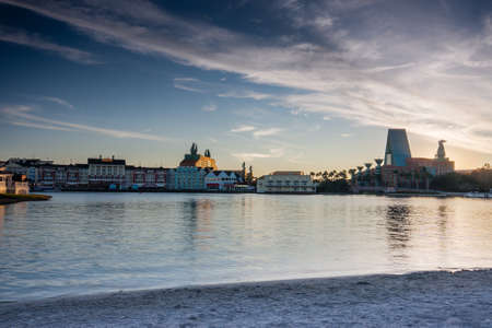 crescent lake: ORLANDO FL USA  JANUARY 15 2012: Boardwalk Disney  area with Swan and Dolphin hotel on Crescent Lake shore at sunset in Orlando on January 15 2012.