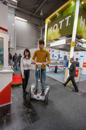 attendee: HANNOVER, GERMANY - MARCH 14, 2016: Attendee tests Segway displayed at CeBIT information technology trade show in Hannover, Germany on March 14, 2016.
