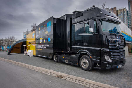 trade show: HANNOVER, GERMANY - MARCH 15, 2016: SAP Go Beyond CRM demo truck stands near SAP company booth at CeBIT information technology trade show in Hannover, Germany on March 15, 2016. Editorial