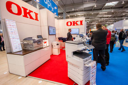 exhibitor: HANNOVER, GERMANY - MARCH 15, 2016: Booth of OKI company at CeBIT information technology trade show in Hannover, Germany on March 15, 2016.