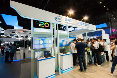 attendee: SHANGHAI, CHINA - SEPTEMBER 2, 2016: Booth of Intel company at Connect 2016 information technology conference and exhibition in Shanghai, China on September 2, 2016.