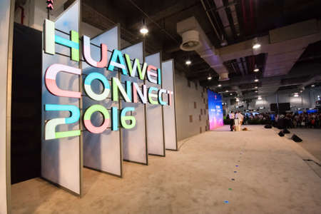 the world expo: SHANGHAI, CHINA - SEPTEMBER 2, 2016: Attendees of Huawei Connect 2016 information technology conference at World Expo Exhibition and Convention Center hall in Shanghai, China on September 2, 2016.