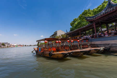 ZHUJIAJIAO, CHINA - AUGUST 30, 2016: Chinese gondolas waits Tourists on canal of ancient water town with a history of more than 1700 years in Zhujiajiao, China, on August 30, 2016. Editorial