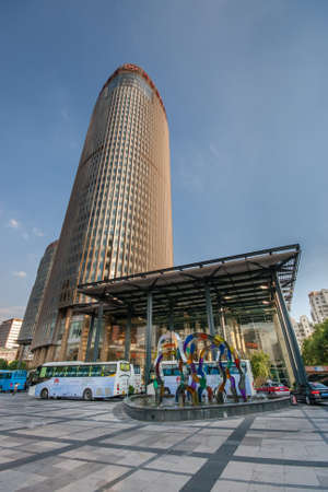 water bus: SHANGHAI, CHINA - AUGUST 30, 2016: Main entrance to Sheraton hotel tower skyscraper in Shanghai, China, on August 30, 2016.