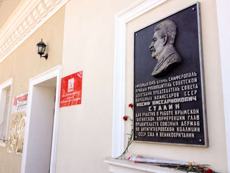 SIMFEROPOL, CRIMEA, UKRAINE - FEB 28, 2017: Memorial plaque in honor of Stalin on main office of Communist Party of Russian Federation CPRF in Simferopol, Crimea, Ukraine on Feb 28, 2017. Editorial