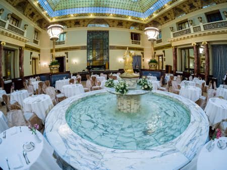 MOSCOW, RUSSIA - APRIL 27, 2017: Marble fountain of Metropol hotel main restaurant in Moscow, Russia on April 27, 2017. Hotel was built in 1899–1907 in Art Nouveau style.