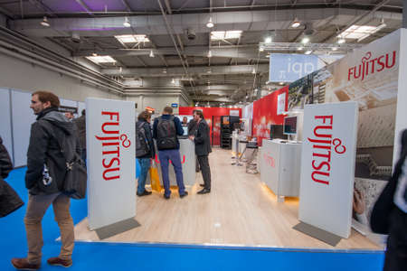 HANNOVER, GERMANY - MARCH 14, 2016: Booth of Fujitsu company at CeBIT information technology trade show in Hannover, Germany on March 14, 2016. Publikacyjne