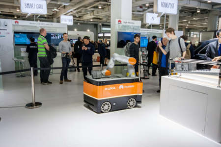 manufacturer: HANNOVER, GERMANY - MARCH 14, 2016: Industrial KUKA robot in booth of Huawei company at CeBIT information technology trade show in Hannover, Germany on March 14, 2016. Editorial