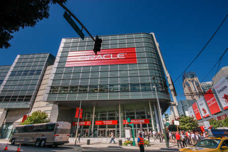 attendee: SAN FRANCISCO, CA, USA - OCT 2, 2012: Attendees of Oracle Open World conference go to  Moscone Center West on Oct 2, 2012 in San Francisco, CA, USA.