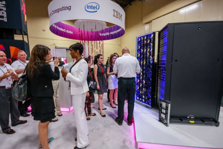 nv: LAS VEGAS, NV - JUNE 10, 2013: Attendees listen stand-attendant at Intel booth of exhibition in frame of IBM Edge 2013 conference on June 10, 2013 in Las Vegas, NV Editorial