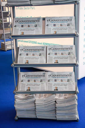 HANNOVER, GERMANY - MARCH 2, 2010: Bookstand with eGovernment newspaper in hall at CeBIT trade show in Hannover, Germany on March 2, 2010. Publikacyjne
