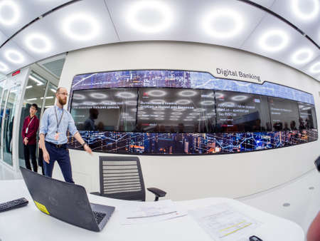 MOSCOW, RUSSIA - APRIL 3, 2018: Huawei Russia manager presents demo stand Digital Banking at event opening OpenLab department on April 3, 2018 in Moscow, Russia.