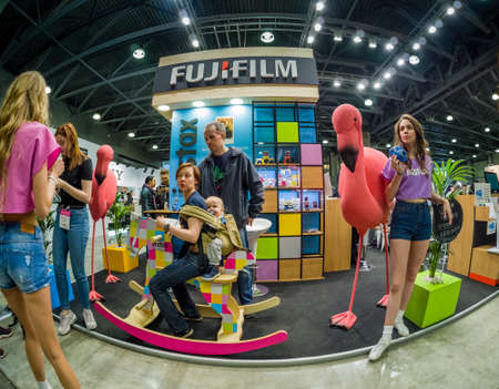 MOSCOW, RUSSIA - APRIL 13, 2018: Booth of Fujifilm company for promotion Instax cameras at PhotoForum 2018 trade show and exhibition in Moscow, Russia on April 13, 2018.